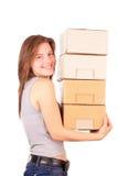 Het jonge meisje gaat zich in een nieuw huis bewegen Stock Afbeelding