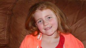 Het jonge meisje glimlachen Stock Foto's