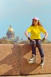 Het jonge meisje op rollen Royalty-vrije Stock Foto's