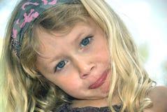 Het jonge meisje pruilen Stock Afbeeldingen