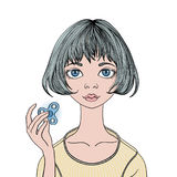 Het jonge meisje spelen met friemelt spinner Handspinner - populair antispanningsstuk speelgoed voor schooljonge geitjes en volwa vector illustratie
