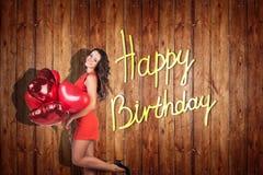 Het jonge meisje viert gelukkige verjaardag Stock Foto's