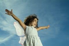 Het jonge meisje vliegen Stock Afbeelding