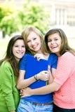 Het jonge meisjes glimlachen Stock Afbeelding