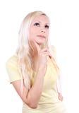 Het jonge mooie het meisje van de blonde geïsoleerda denken, royalty-vrije stock afbeelding
