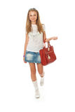 Het jonge mooie meisje met een zak Stock Afbeelding