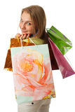 Het jonge mooie meisje met pakketten Stock Fotografie