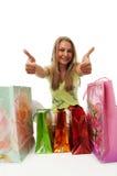 Het jonge mooie meisje met pakketten Stock Foto's