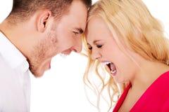 Het jonge paar die hebben debatteert stock afbeelding