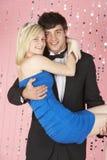 Het jonge Paar kleedde zich voor Partij Stock Foto's