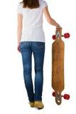 Het jonge skateboard van de vrouwenholding Royalty-vrije Stock Fotografie
