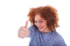 Het jonge Spaanse tiener maken beduimelt geïsoleerd omhoog gebaar Stock Afbeelding