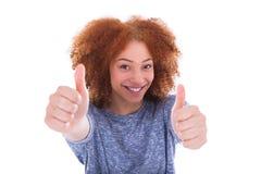 Het jonge Spaanse tiener maken beduimelt omhoog gebaar Stock Foto