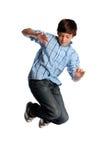 Het jonge Springen van de Jongen Stock Afbeeldingen