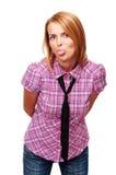 Het jonge toevallige meisje toont haar tong Stock Foto's