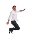 Het jonge toevallige mens springen Royalty-vrije Stock Foto's