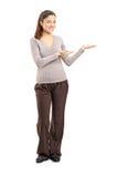 Het jonge vrouw gesturing Stock Foto