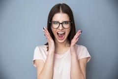 Het jonge vrouw gillen Stock Foto
