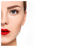 Het jonge vrouwelijke gezicht Antiaging en draad het opheffen concept royalty-vrije stock afbeelding