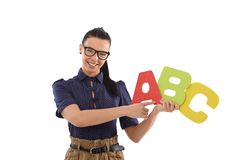 Het jonge vrouwelijke het alfabet van het leraarsonderwijs glimlachen Royalty-vrije Stock Foto's