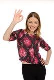 Het jonge vrouwelijke tonen duimen omhoog Royalty-vrije Stock Afbeeldingen