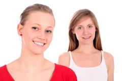 Het jonge vrouwen glimlachen stock afbeeldingen