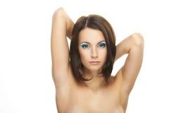 Het jonge vrouwenclose-up hief haar wapens op Stock Foto's