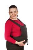 Het jonge zwangere vrouw glimlachen die camera bekijkt Royalty-vrije Stock Afbeeldingen