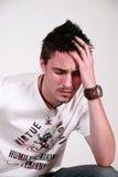 Het jongere mannelijke, sjofele kijken Stock Foto