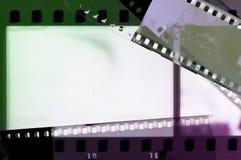 Het kader van de filmstrook in groene en purpere tonen Stock Foto's