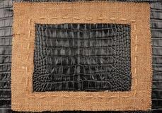 Het kader van jute, ligt op een achtergrond van leer Royalty-vrije Stock Afbeelding