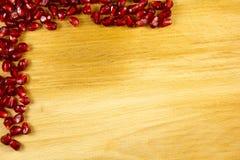 Het kaderachtergrond van het granaatappelzaad Stock Afbeeldingen
