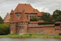 Het kasteelingang van Malbork Stock Foto