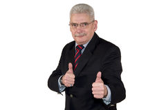Het Kaukasische hogere manager stellen met omhoog duimen Stock Fotografie