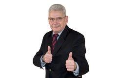 Het Kaukasische hogere manager stellen met omhoog duimen Stock Foto