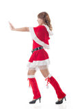 Het Kerstmismeisje duwt iets royalty-vrije stock afbeeldingen