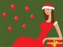 Het Kerstmismeisje met een gift Stock Afbeelding