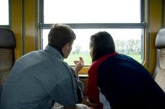 Het kijken uit venster 2 Stock Foto's