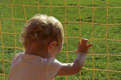Het kind dat vrij wil breken Stock Foto