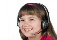 Het kind in de hoofdtelefoon. Royalty-vrije Stock Afbeeldingen