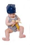 Het kind eet banaan royalty-vrije stock afbeelding