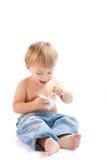 Het kind eet yoghurt Royalty-vrije Stock Foto's