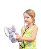 Het kind en het stuk speelgoed Royalty-vrije Stock Afbeeldingen