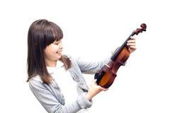Het kind houdt de viool en het glimlachen Stock Foto