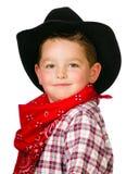 Het kind kleedde zich omhoog als cowboy het spelen Stock Fotografie