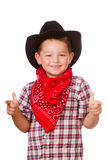 Het kind kleedde zich omhoog als cowboy het spelen Stock Afbeeldingen