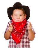 Het kind kleedde zich omhoog als cowboy het spelen Royalty-vrije Stock Foto's