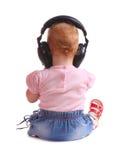 Het kind luistert aan muziek Stock Afbeeldingen