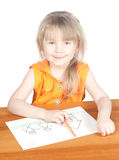 Het kind trekt bij de lijst Royalty-vrije Stock Foto's