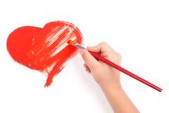 Het kind trekt een hart Stock Afbeelding